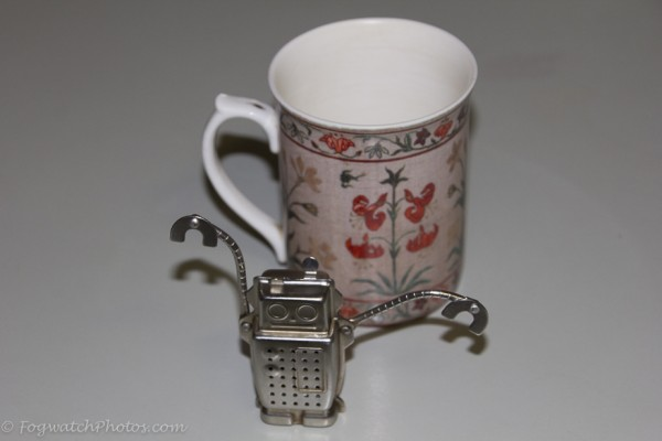 Tea infuser with cup shown for scale